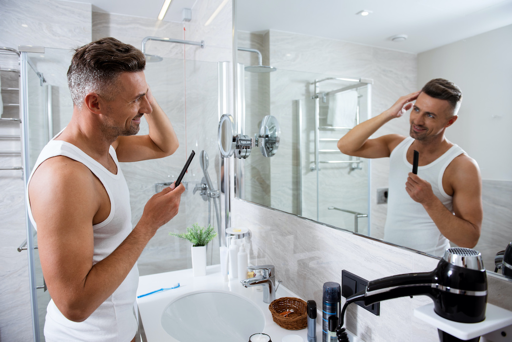 Man at bathroom mirror | Terry's Plumbing Pittsburgh