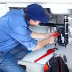 Plumber fixing sink drain pipe | Terry's Plumbing Pittsburgh